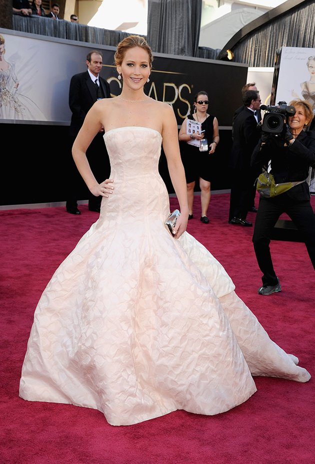 Jennifer Lawrence in the dress that made her trip at the Oscars. By Dior Haute Couture